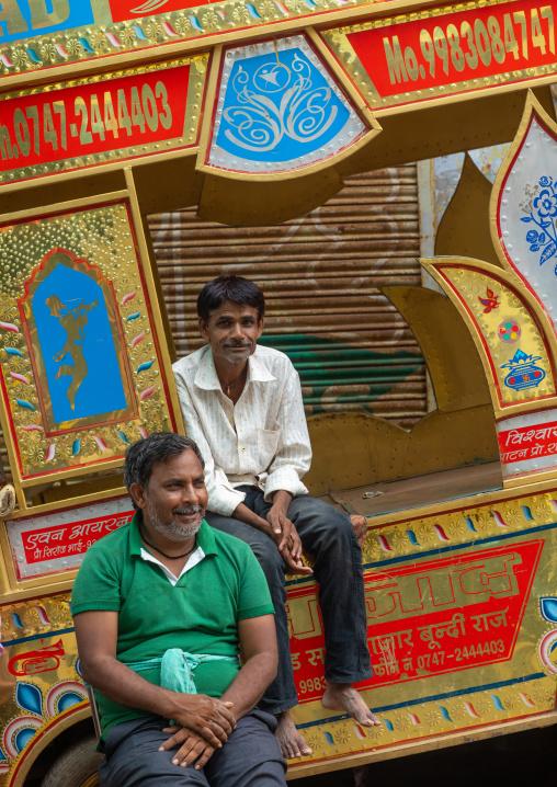 Portrait of indian musician sit on their rickshaw, Rajasthan, Bundi, India