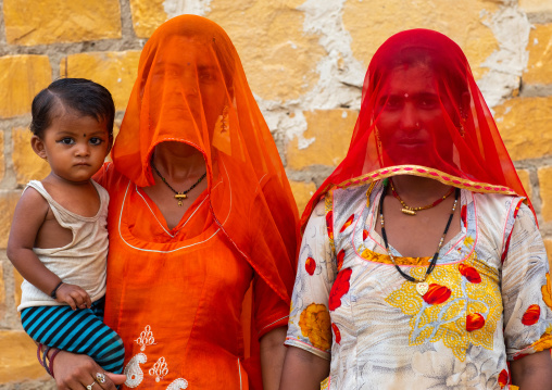 Portrait of rajasthani women with face hidden by their saris, Rajasthan, Jaisalmer, India