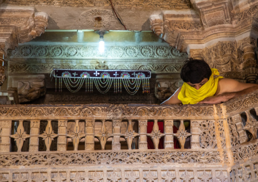 Indian priest covering his mouth inside a jain temple, Rajasthan, Jaisalmer, India