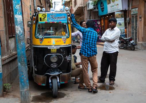 Indian men chatting near a rickshaw parked in city, Rajasthan, Jodhpur, India