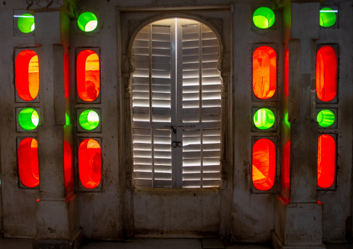 Multi coloured stained glass windows in the city palace, Rajasthan, Udaipur, India