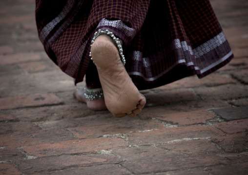 Calloused Feet Of A Woman With Ankle Bangles Walking On Thanjavur's Street, India