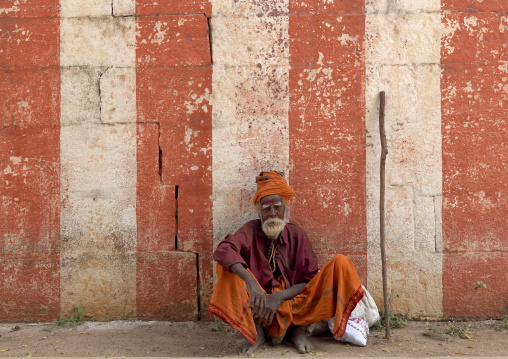 Old Sadhu Squatting In Front Of A Temple, Mahabalipuram, India