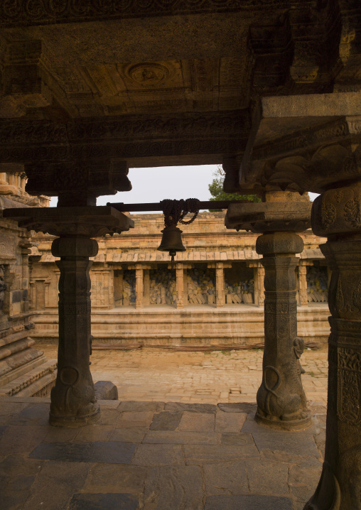 Intricately Carved Stone Pillars Holding A Bell At The Airavatesvara Temple, Darasuram, India
