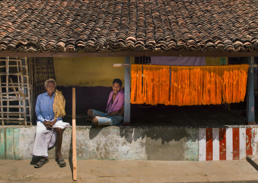 Men Sitting On The Wall In Front Of Their House With A Tiled Roof, Kumbakonam, India