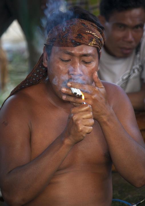 Local Doctor Smoking Cigarettes, Magbesik, Lombok Island, Indonesia