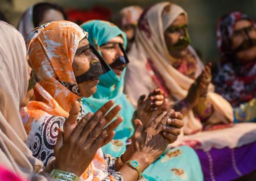 women with traditional burqas masks during a zar ceremony, Qeshm Island, Salakh, Iran