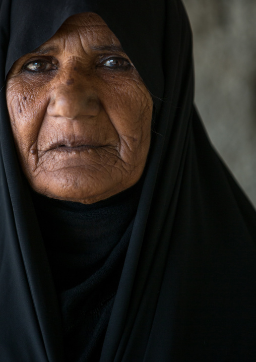 portrait of a an old woman begging from house to house, Hormozgan, Kushkenar, Iran