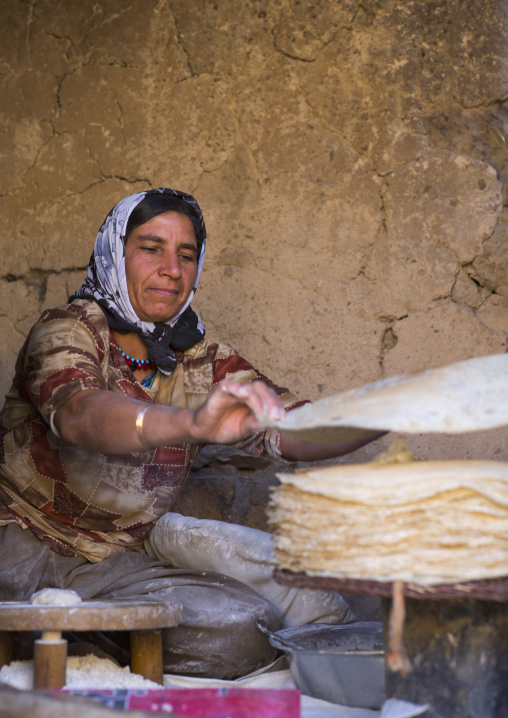 Kurdish woman making local bread, Palangan, Iran