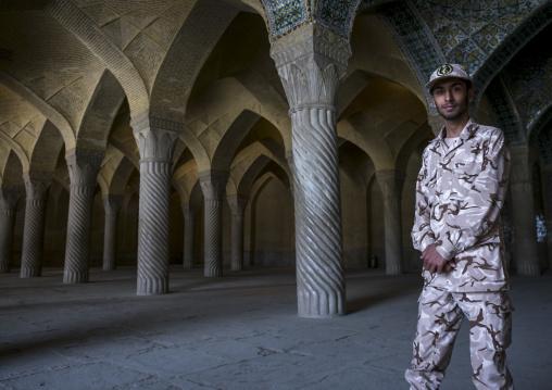 Soldier inside vakil mosque prayer hall, Fars province, Shiraz, Iran