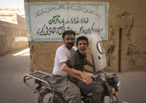Man and son on motorbike, Isfahan province, Kashan, Iran