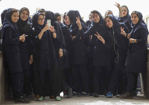 Iranian students women taking pictures with mobile phones, Isfahan province, Isfahan, Iran