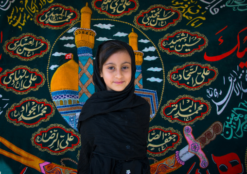 Portrait of an iranian shiite muslim girl in front of a muharram flag, Isfahan province, Isfahan, Iran