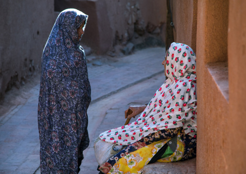 Iranian women wearing traditional floreal chadors in zoroastrian village, Natanz county, Abyaneh, Iran