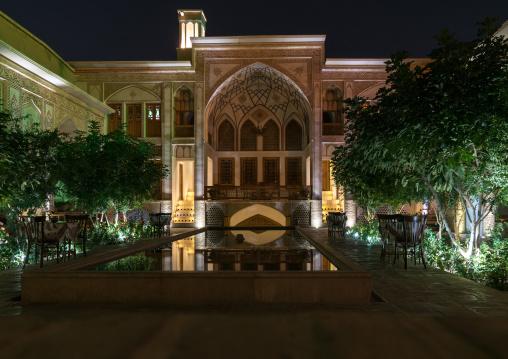 Mahinestan Raheb hotel courtyard at night, Isfahan Province, Kashan, Iran