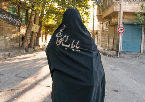 Iranian shiite muslim woman after rubbing mud on her chador during the Kharrah Mali ritual to mark the Ashura ceremony, Lorestan Province, Khorramabad, Iran