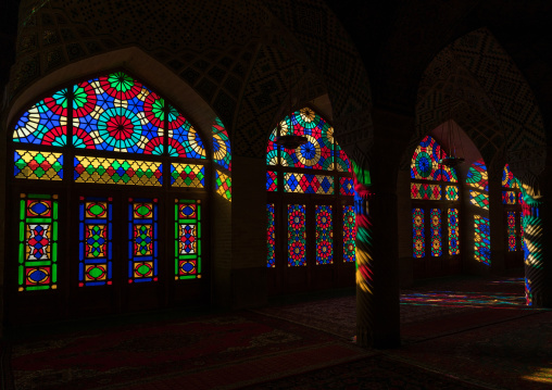 The prayer hall of nasir ol molk mosque with its beautiful coloured glass windows, Fars province, Shiraz, Iran