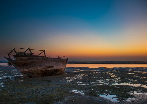 dhow boat at low tide, Qeshm Island, Laft, Iran