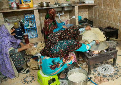 bandari women wearing the traditional masks in a kitchen, Qeshm Island, Salakh, Iran