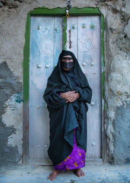 an old bandari woman wearing a traditional mask called the burqa, Qeshm Island, Salakh, Iran