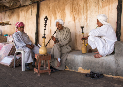 Old bandari sailors smoking pipes, Hormozgan, Bandar-e kong, Iran