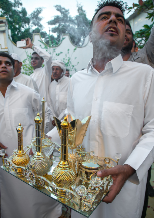 man carrying incense and perfumes for the wedding ceremony, Hormozgan, Bandar-e Kong, Iran