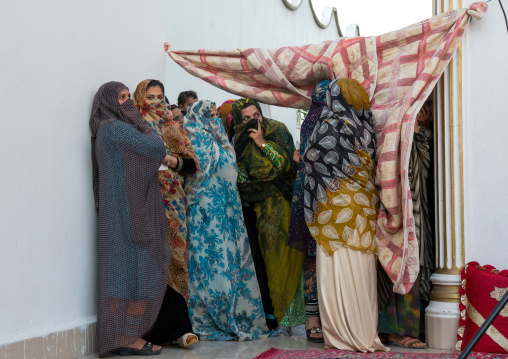 Women looking a wedding ceremony, Hormozgan, Bandar-e kong, Iran