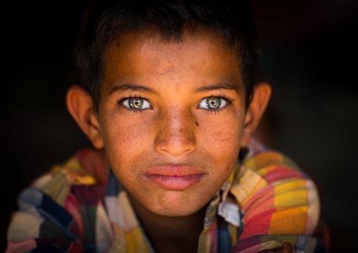 Gypsy boy with beautiful eyes, Central county, Kerman, Iran