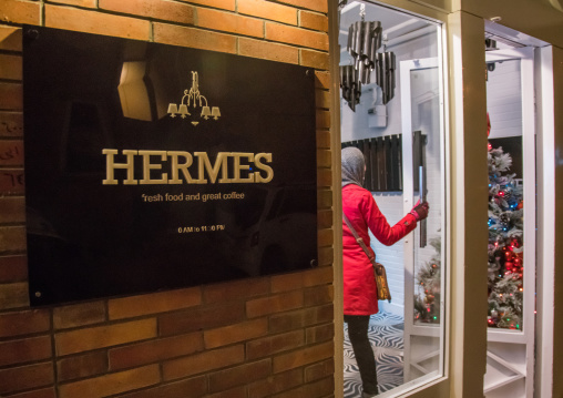 Iranian woman going inside hermes restaurant, Isfahan province, Isfahan, Iran