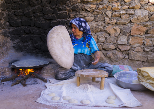 Woman Making Local Bread In The Old Kurdish Village Of Palangan At Dusk, Iran