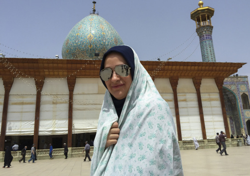 Woman with sunglasses in the shah-e-cheragh mausoleum, Fars province, Shiraz, Iran