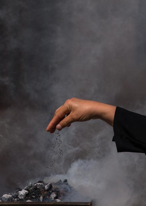 Shia Muslims Women Lighting Incense During Chehel Menbari Festival On Tasua Day For Ashura Celebration, Lorestan Province, Khorramabad, Iran