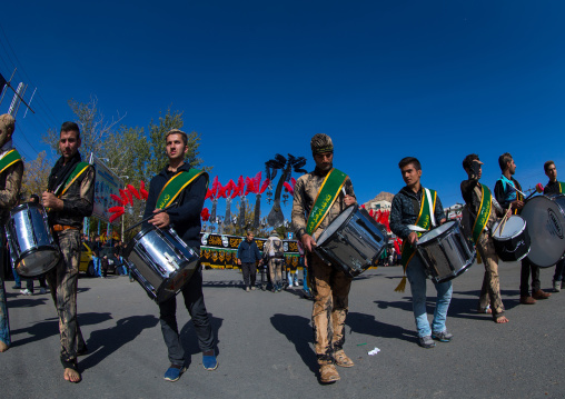 Iranian Shiite Muslim Men Playing Drums In Front Of An Alam During Ashura, The Day Of The Death Of Imam Hussein, Kurdistan Province, Bijar, Iran