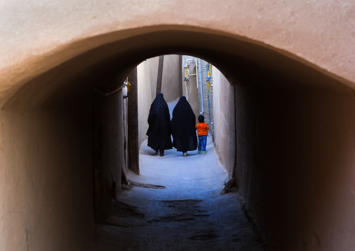 Women With A Child Walking Ina Narrow Street With Arches, Yazd Province, Yazd, Iran