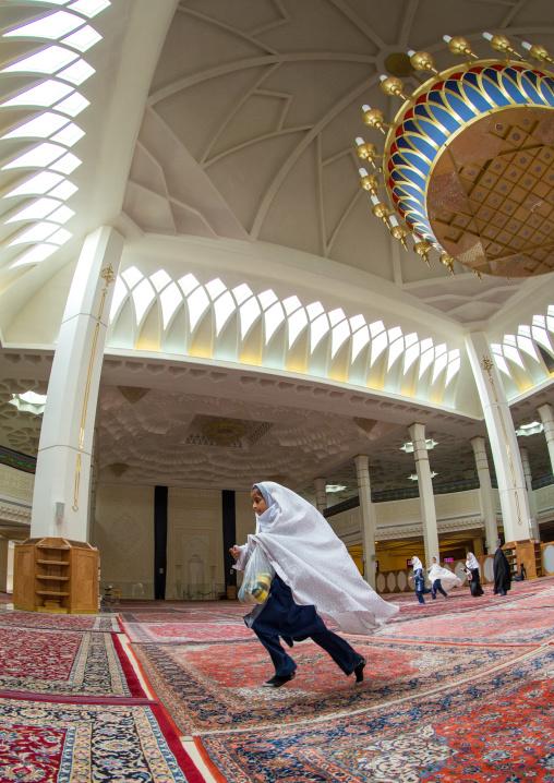 Muslim Girl Running In The Shah-e-cheragh Mausoleum, Fars Province, Shiraz, Iran