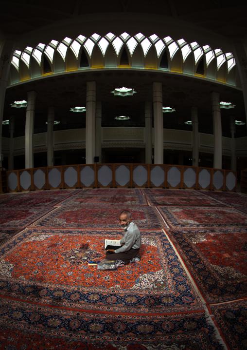 Iranian Shiite Muslim Man Reading The Koran In Fatima Al-masumeh Mosque, Fars Province, Shiraz, Iran