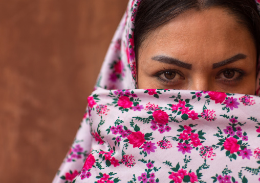 Portrait Of An Iranian Woman Wearing Traditional Floreal Chador In Zoroastrian Village, Isfahan Province, Abyaneh, Iran