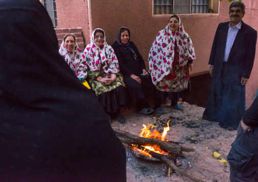 Portrait Of Iranian Women Wearing Traditional Floreal Chadors And Men In Zoroastrian Village, Isfahan Province, Abyaneh, Iran