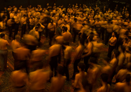 Iranian Shiite Muslim Mourners From The Mad Of Hussein Community Chanting And Self-flagellating In Circle During Muharram, Isfahan Province, Kashan, Iran