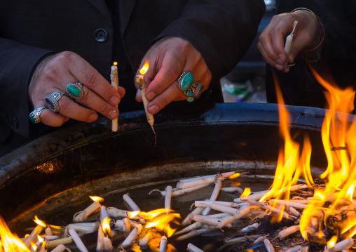 A Man Lights Candles During Chehel Menbari Festival Ton Tasu'a Day To Commemorate The Martyrdom Anniversary Of Imam Hussein, Lorestan Province, Khorramabad, Iran