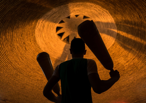 Iranian Man Wielding Wooden Clubs During The Traditional Sport Of Zurkhaneh, Yazd Province, Yazd, Iran