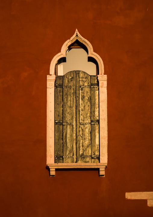 Venetian window on a red historic house, Veneto Region, Venice, Italy