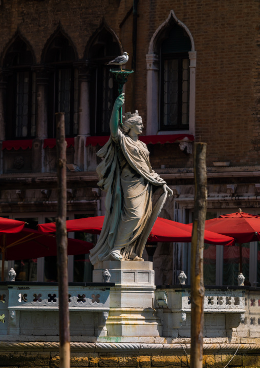 Statue of a lady with a torch on the grand canal, Veneto Region, Venice, Italy