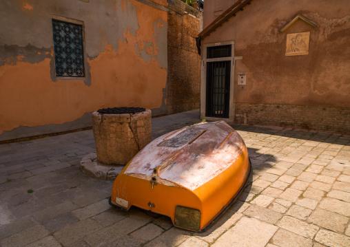 Wooden boat on a square in the city, Veneto Region, Venice, Italy