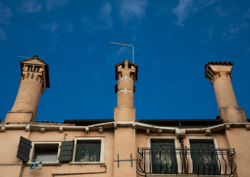 Chimneys of an old house against the sky, Veneto, Venice, Italia