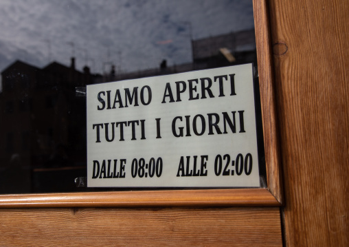 Open sign in a shop written in italian language, Veneto, Venice, Italia