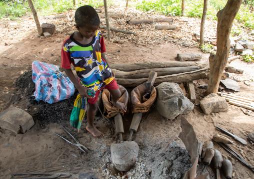 Child in a blacksmith workshop, Bafing, Yo, Ivory Coast