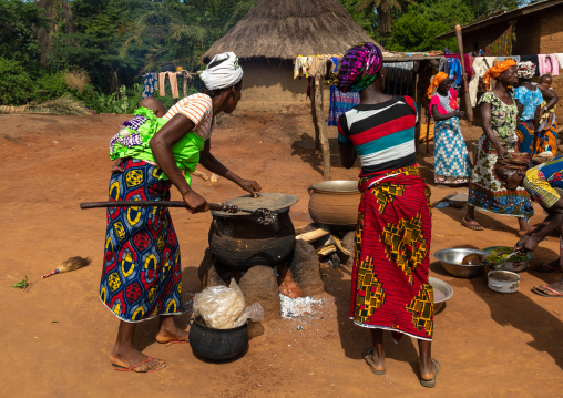 African women cooking in a village, Bafing, Gboni, Ivory Coast
