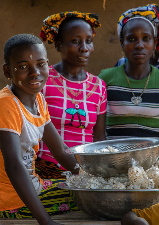 African girl and woman in a market, Bafing, Gboni, Ivory Coast