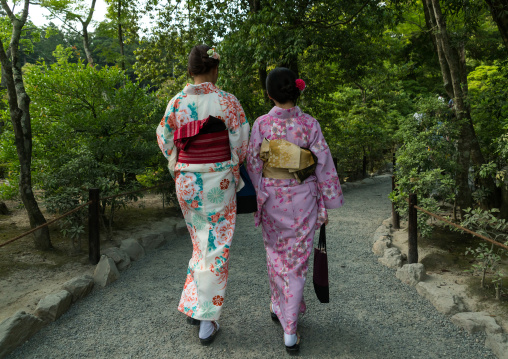 Chinese tourist women wearing geisha kimonos in a zen garden, Kansai region, Kyoto, Japan